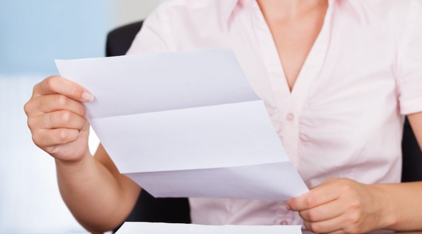 Closeup Of Young Businesswoman Holding Envelope With Letter